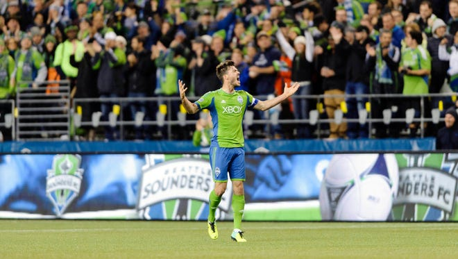 Seattle Sounders midfielder Brad Evans (3) celebrates after scoring a goal against the Colorado Rapids during the 1st half at CenturyLink Field.
