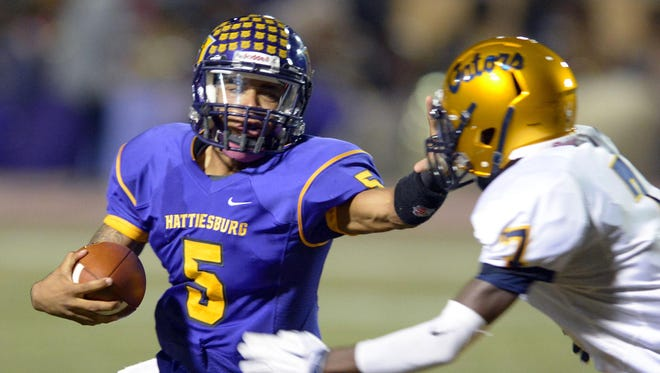 Hattiesburg quarterback Julian Conner carries the ball during the Tigers' Friday night game against Gautier.