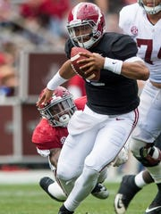 Jalen Hurts (2) carries during the A-Day Game at Bryant-Denny Stadium on Saturday April 21, 2018.