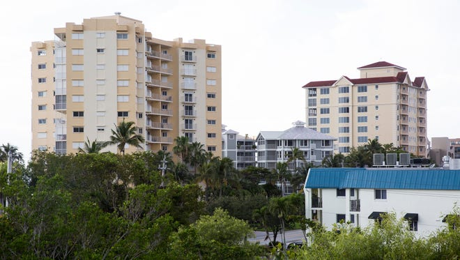 Another high-rise condo could be in the works as Vanderbilt Holdings LLC, an affiliate of Stock Development, wants to develop a project called One Naples that would include an 18-story condo on the corner of Vanderbilt Beach Road and Gulf Shore Drive, seen at bottom right, Tuesday, May 16, 2017, in Naples. The condo would affect local businesses such as The Beach Box and a beach store.