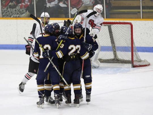 Wausau West players celebrate their win during the game between SPASH and Wausau West in Stevens Point, January 12, 2017. SPASH fell 2-7 to the Warriors.