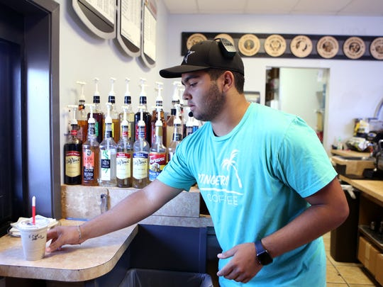DJ Lopez, 16, works at Stingers Coffee in May. The Ray High School student started working after his father was laid off and despite the fact that his father has found work again he continues to work.