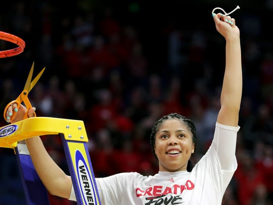 Louisville's Arica Carter cuts down the net after the Cards defeat Oregon State and earn a trip to the Final Four. 