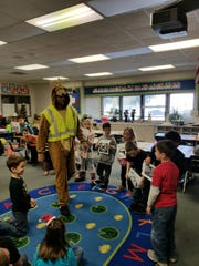 RPD Officer Tim Davis dressed as a reindeer for a 12 Days of Safety program he presented to Westview Elementary students.