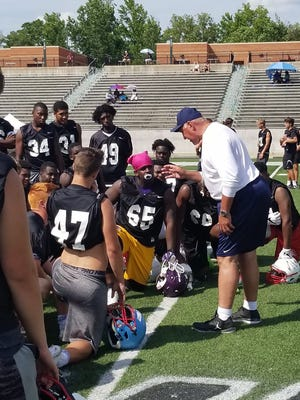 Michigan defensive line coach Greg Mattison talks to players during the satellite camp in Charlotte, N.C., Sunday.