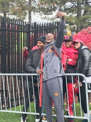Iowa State wide receiver Matthew Eaton takes a picture while carrying the Iowa State shovel passed on to a different player each week.