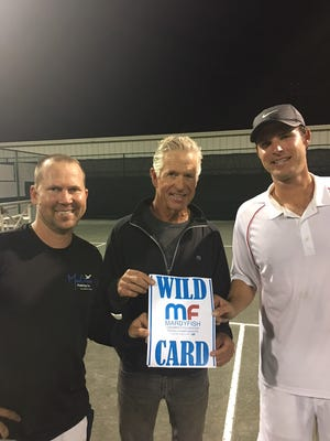Robert Kowalczyk (left) and King of the Hill open division champion Michael Alford (right) receive atheir wild card entry into the main doubles draw of the Mardy Fish Children's Foundation USTA Championships in April by tournament director Tom Fish.