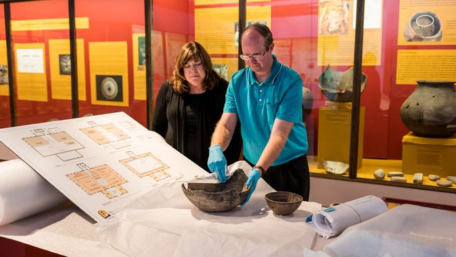 Pictured are Dr. Cynthia Bettison, University Museum Director; and Phillip Cave, Museum Assistant Director; wrapping artifacts.