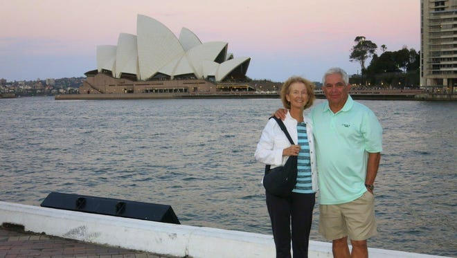 Ernie and Linda Dorling stand in front of the world famous Sydney Opera House on Bennelong Point.