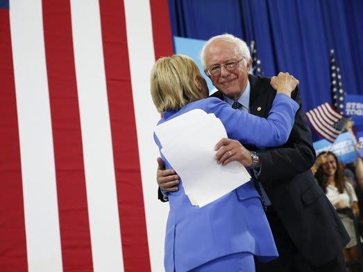 Hillary Clinton hugs Bernie Sanders, during a rally