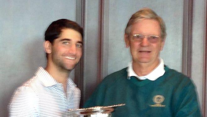 David Weisfeld gets the WGA Mid-Amateur Championship trophy from Bob Ferguson.