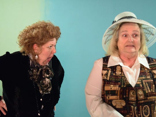 "Lady Bracknell (left, played by Maggie Wirth) scolds Mrs. Prism (Bonnie Rohn) for losing a baby. They will appear in the Village Playhouse production of ""the Importance of Being Earnest"" to open at Inspiration Studios in West Allis."