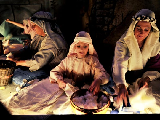 """Woodmont Christian Church's annual living nativity """"Walk Thru Bethlehem"""" recreates a village of the ancient world with textile weavers, olive oil grinders, vendors making crafts."""
