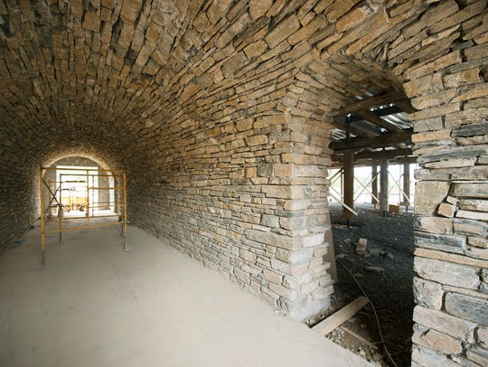 An arched stone tunnel was taken apart and rebuilt