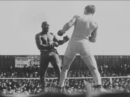 "World heavyweight champion Jack Johnson battles with challenger Al Kaufmann — the latest in a string of ""Great White Hopes"" — in a 1909 title bout."