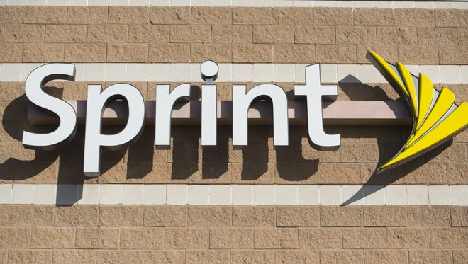 A Sprint cell phone company logo is seen on a store in New Carrollton, Maryland, December 31, 2014.