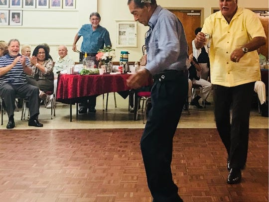 "Spanish American Club member Ray ""Zorba"" Matias dances"
