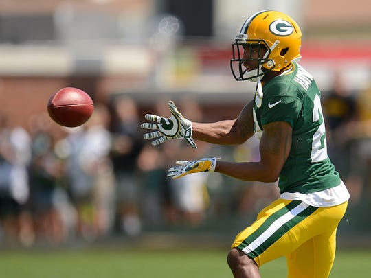 Green Bay Packers cornerback Casey Hayward makes a catch while running drills during training camp practice at Ray Nitschke Field.