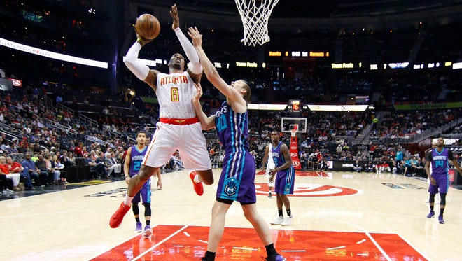 Atlanta Hawks center Dwight Howard (8) shoots the ball over Charlotte Hornets center Cody Zeller (40) in the first half at Philips Arena.