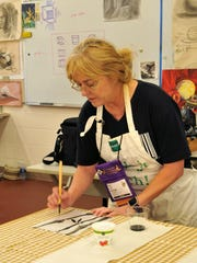 Ruthie Platt taught a Japanese brush painting workshop at the FAEA conference.