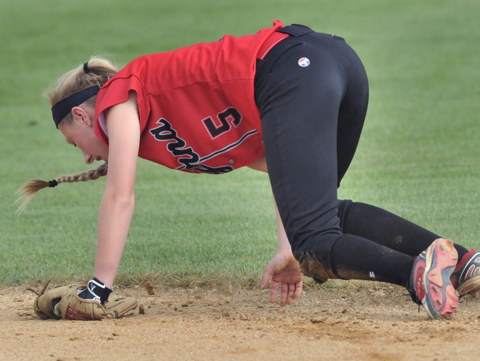 Smyrna second baseman Kristen Fuhr makes a diving attempt to stop a single up the middle in game with Sussex Tech Thursday. Fuhr was injured on the play and had to be replaced.