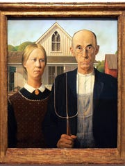 "Grant Wood's ""American Gothic,"" shown on exhibit at the Des Moines Art Center in 2009, is one of the best-known works of the Iowa native."