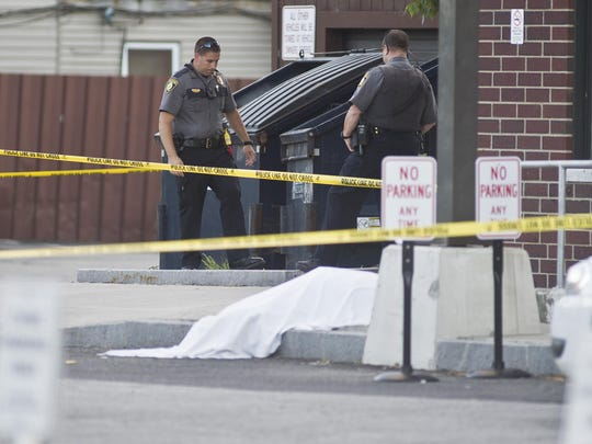 Barre police guard the scene of a fatal shooting behind Barre City Place on Friday night. A Vermont Department for Children and Families worker was shot and killed by a mother after losing custody of her child, state officials say.