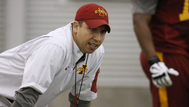 Head football coach Matt Campbell looks on as players run through drills Tuesday, March 8, 2016, during spring practice in the Bergstrom Football Complex at Iowa State University in Ames.