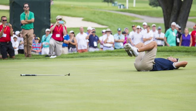 Nick Carlson reacts to his missed putt on the 21st hole during the semifinal round of match play at the 2016 U.S. Amateur at Oakland Hills Country Club in Bloomfield Hills, Mich. on Saturday, Aug. 20, 2016.