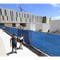 Eastwood High School students make their way between classes Thursday through a construction zone. The new three story school, background has portions which are now complete including the science wing and fine arts wing.