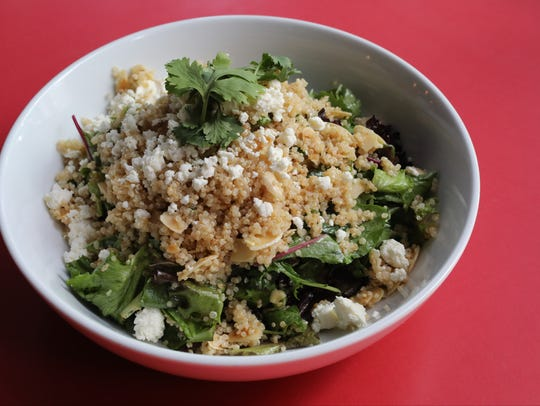 The Quinoa Salad with feta cheese, carmelized onions,