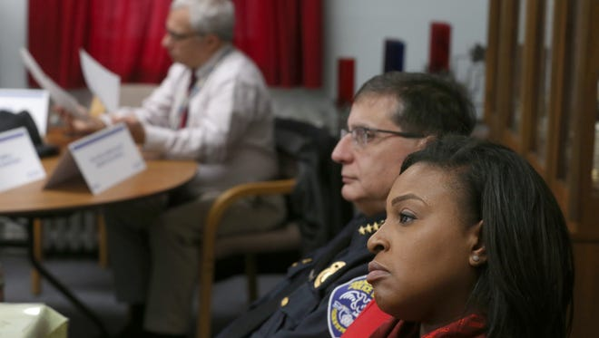 Rochester Mayor Lovely Warren, right, and Police Chief Michael Ciminelli listen to questions during a presentation on the drug problem around North Clinton Ave. during a meeting with members of the Democrat & Chronicle Thursday, Dec. 8, 2016, at St. Michael's Church at the corner of N. Clinton and Evergreen St.