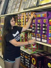 Alyssa Larson, an employee at Planet Fireworks in Jolly,