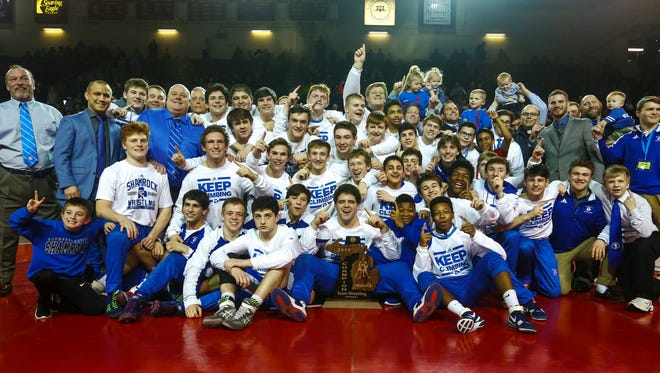 Detroit Catholic Central celebrates after winning the MHSAA Division 1 wrestling title in Mount Pleasant.