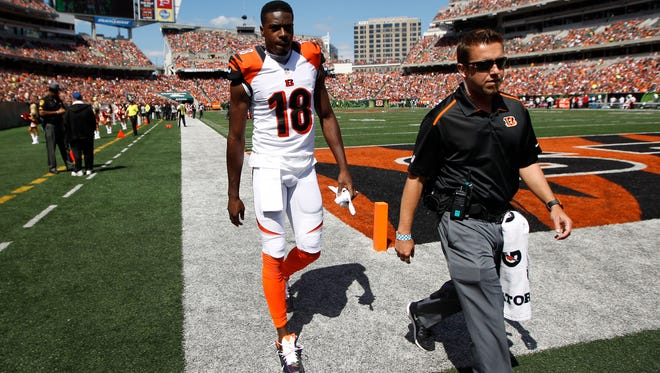 Bengals wide receiver A.J. Green walks off the field with a toe injury during Sunday's game against the Atlanta Falcons at Paul Brown Stadium.