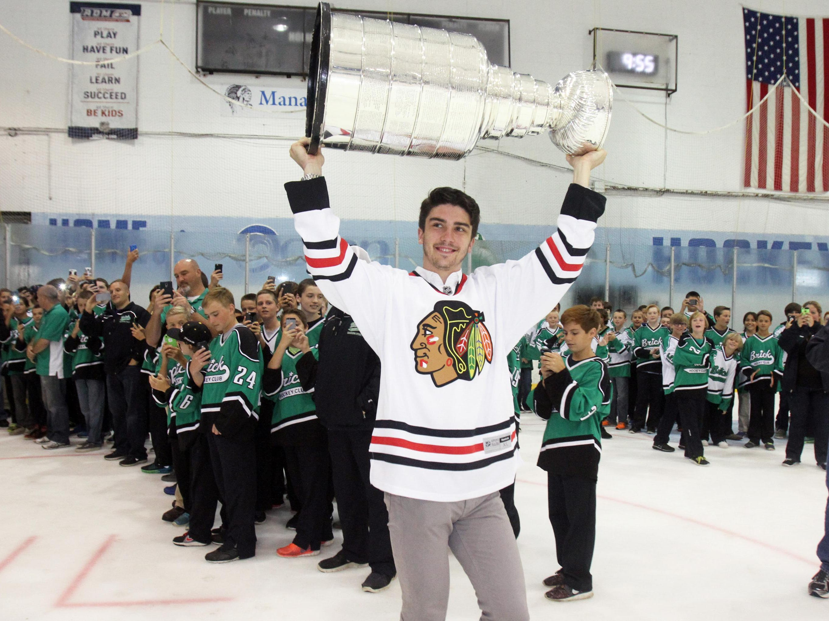 Former CBA standout and member of the Chicago Blackhawks Trevor van Riemsdyk brings the Stanley Cup onto the ice at the Ocean Ice Palace in Brick on July 30.