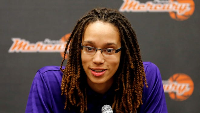 FILE - In this April 20, 2013 file photo, Phoenix Mercury's Brittney Griner, the No. 1 overall pick the WNBA draft, speaks during a news conference  in Phoenix. The WNBA is launching a campaign to market specifically to the gay, lesbian, bisexual and transgendered community. It's the first league to design such a campaign. Griner, who is one of a handful of WNBA athletes who have publicly identified themselves as lesbian, was happy the league was embracing the community.  (AP Photo/Matt York, File)