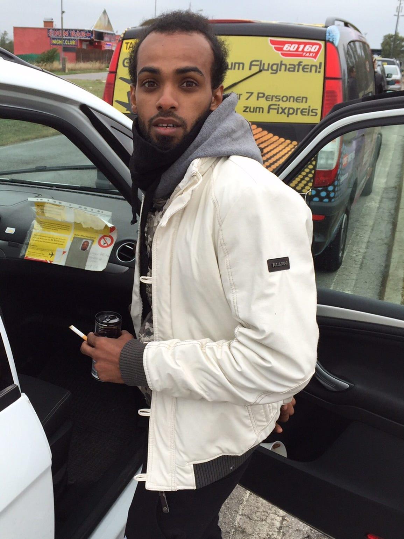 Abdullah, 23, from Yemen, is seen outside a migrants