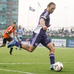 Louisville City FC forward Matt Fondy takes a shot for his second goal in the first half against Harrisburg City Islanders on Wednesday night. Fondy would have three in the first half. Sept. 3, 2015