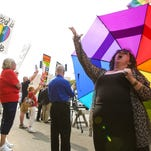 Gay marriage supporter Hexie Mefford cheers with supporters outside the Carl D. Perkins Federal Building in Ashland, Ky. for the hearing of Morehead, Ky. county clerk Kim Davis. Sept. 3, 2015
