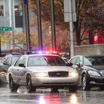 An LMPD car pulls over along Jefferson Street in downtown Louisville on Wednesday. Nov. 18, 2015
