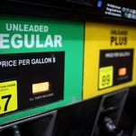 Gasoline prices are projected to be the lowest in years on Thanksgiving day. In this file photo, a gasoline pump displays different grades of unleaded fuel available at a Hess Corp. gas station in Gordonsville, Tennessee, U.S. on Saturday, Oct. 24, 2015.
