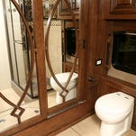 A look at the master bathroom in the Cornerstone Entegra RV, which features a cedar lined closet with a mirro inlay.