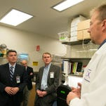 Sens. Cory Gardner and Michael Bennet tour the CDC's insectary at CSU