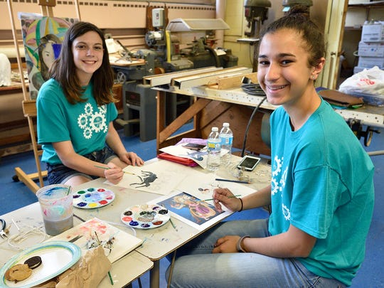 Kaylee Babasade and Christine Bellanich work on their