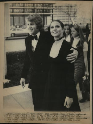 Ryan O'Neal and wife Leigh Taylor-Young in 1971. Taylor-Young grew up in Oakland County