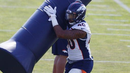 Denver Broncos linebacker Justin Strnad takes part in drills during an NFL football practice at the team's headquarters last week at Dove Valley in Englewood.