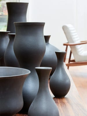 Curvy vessels like these rendered in matte gray, carbon and ivory could adorn a tablescape or mantel with shinier pieces.