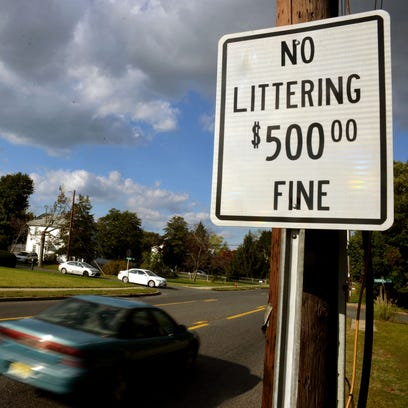 No Littering $500 Fine a sign reminds Main Road passersby
