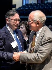 Lewis Thayne, president of Lebanon Valley College, shakes hands with Edward Arnold after it was announced Friday, April 15, 2016, that Arnold and his wife, Jeanne Arnold, were donating $10 million toward the construction of the new Health Professions Building on the Lebanon Valley College campus. The building is slated to open in 2018. The donation was also the largest in the history of the college.
